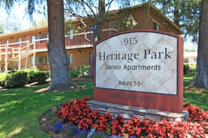 Heritage Park exterior with Heritage Park Senior Apartments 55+ (626) 357-5118 outdoor sign