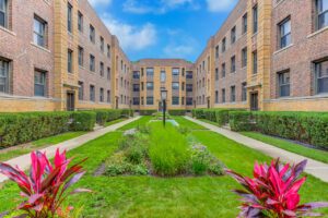 Scotland Yard exterior and courtyard with greenery and flowering plants